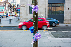 "DATE CORRECTION - IMAGES SHOT TODAY © Licensed to London News Pictures. 07/02/2018. Picture shows ribbons tied to tree's in support of Alfie Evans outside Liverpool Civil & Family Court this morning. Tom Evans and Kate James from Liverpool are in dispute with medics looking after their son 19-month-old son Alfie Evans, at Alder Hey Children's Hospital in Liverpool. Alfie is in a ""semi-vegetative state"" and had a degenerative neurological condition doctors have not definitively diagnosed. Specialists at Alder Hey say continuing life-support treatment is not in Alfie's best interests but the boy's parents want permission to fly their son to a hospital in Rome for possible diagnosis and treatment. Photo credit: Andrew McCaren/LNP"