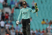 Jason Roy of Surrey raises his bat as he reaches his half century during the NatWest T20 Blast South Group match between Surrey County Cricket Club and Warwickshire County Cricket Club at the Kia Oval, Kennington, United Kingdom on 25 August 2017. Photo by Dave Vokes.