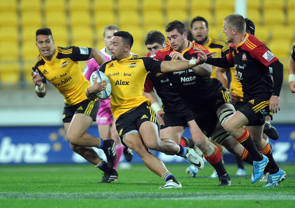 Hurricanes' Matt Proctor makes a break against the Chiefs in the Super Rugby match at Westpac Stadium, Wellington, New Zealand, Saturday, May 24, 2014. Credit:SNPA / Ross Setford