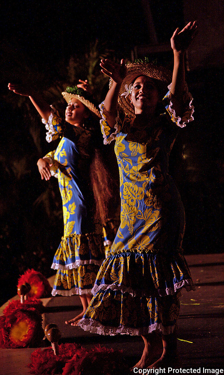 Dancers perform at a Luau in Kaanapoli, Maui.  The Hawaiian Island is a popular tourist destination.