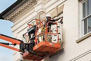 Workers attach hurricane resistant cloth to windows on the historic Charleston County Courthouse in preparation for approaching Hurricane Florence September 10, 2018 in Charleston, South Carolina. Florence, a category 4 storm, is expected to hit the coast between South and North Carolina and could be the strongest storm on record for the East Coast of the United States.