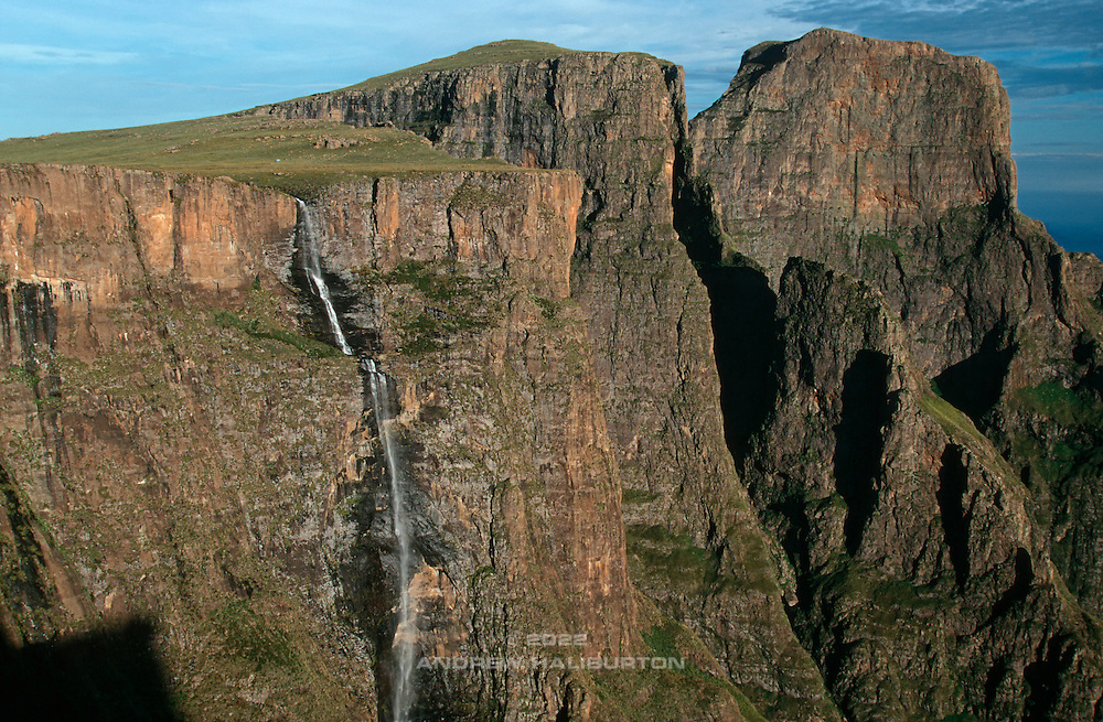 Tugela Falls 183m max clear drop (614m overall) and Amphitheatre with Beacon Buttress 3121m and Sentinel 3165m (right). Ukhahlamba-Drakensberg Park, KwaZulu-Natal, South Africa.  Nikon F90, 35-135/3.5. E100SW. December 1996.