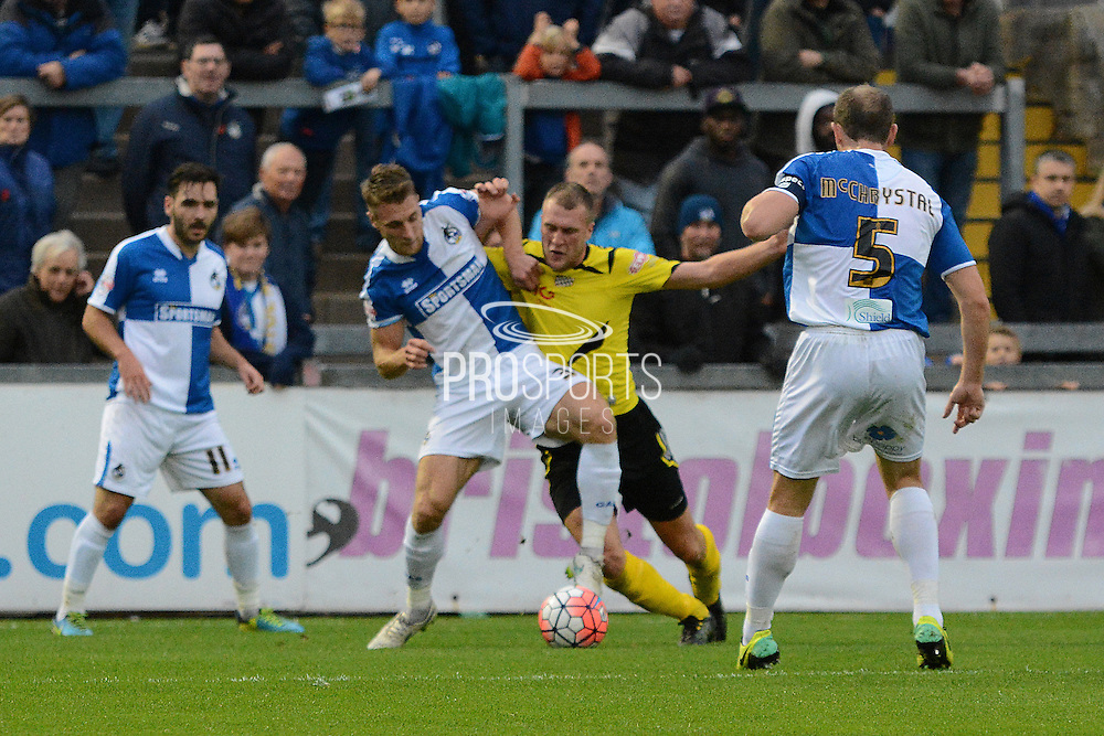 Chesham United striker Brad Wadkins battles with Bristol Rovers defender Lee Brown during the The FA Cup match between Bristol Rovers and Chesham FC at the Memorial Stadium, Bristol, England on 8 November 2015. Photo by Alan Franklin.