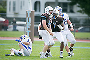 09/20/2014 - Somerville, Mass. - Tufts LB Matt McCormack, A16, left, celebrates with Tufts LB Patrick Williams, A16, after tackling Hamilton RB Jeff Hopsicker for a loss in Tufts' 24-17 win over Hamilton at Zimman Field on Sept. 20, 2014. The win snapped a 31-game losing streak. (Kelvin Ma/Tufts University)