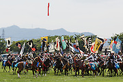 Minami-Soma, Fukushima prefecture, July 25 2015 - Shinki Sodatsusen, one of the  highlight of Nomaoi, a festival of Samurai riding horses. Hundreds of samurai horsemen compete for flags shot into the air.<br /> The Soma nomaoi is said to be a 1000-year-old traditional festival. It was held in 2011, a few months after the nuclear disaster, but only a few local horses were available.