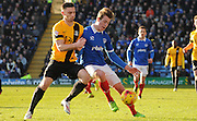Jake Cassidy challenging Adam Webster for the ball during the Sky Bet League 2 match between Portsmouth and Southend United at Fratton Park, Portsmouth, England on 24 January 2015. Photo by Michael Hulf.