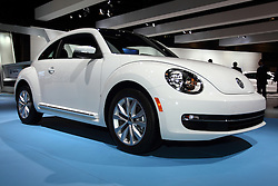 12 February 2015: 2015 VOLKSWAGEN BEETLE: On display at the 107th annual Chicago Auto Show, Feb.14-22, 2015, is the Volkswagen Beetle, the modern interpretation of an icon. New for 2015 are the Beetle Classic model and a new turbodiesel engine. The Beetle Classic is a limited-edition model that builds off the base Beetle and adds features such as a unique seat fabric, front lumbar supports, a navigation system, and a six-speed automatic transmission. Seventeen-inch wheels are available. The new 2.0-liter turbodiesel engine replaces the outgoing 2.0-liter TDI, and it makes 10 more horsepower, bumping the number up to 150. When equipped with the available six-speed DSG automatic, the diesel's highway fuel economy number goes from 39 mpg to 41 mpg. The retro-influenced Beetle remains available as a hardtop or convertible, and in addition to the turbodiesel it offers a 1.8-liter turbocharged four-cylinder engine that mates to either a five-speed manual transmission or six-speed automatic, or a 2.0-liter turbocharged four-cylinder that mates to a six-speed manual transmission or six-speed automatic. The 1.8-liter engine makes 170 horsepower and the 2.0-liter engine produces 210 horsepower, and it powers the sporty R-Line trim. The 1.8 achieves 24 mpg city and 33 mpg highway with the manual and 25/33 with the automatic, while the 2.0-liter achieves 24/30 with the DSG automatic and 23/31 with the six-speed manual. The diesel can get 31 mpg city/41 mpg highway with the manual, in addition to the 41 mpg highway from the automatic.<br /> <br /> First staged in 1901, the Chicago Auto Show is the largest auto show in North America and has been held more times than any other auto exposition on the continent. The 2015 show marks the 107th edition of the Chicago Auto Show. It has been  presented by the Chicago Automobile Trade Association (CATA) since 1935.  It is held at McCormick Place, Chicago Illinois