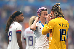 USA's Megan Rapinoe (centre) and goalkeeper Ashlyn Harris after the final whistle after the FIFA Women's World Cup 2019 Final at the Stade de Lyon, Lyon, France.