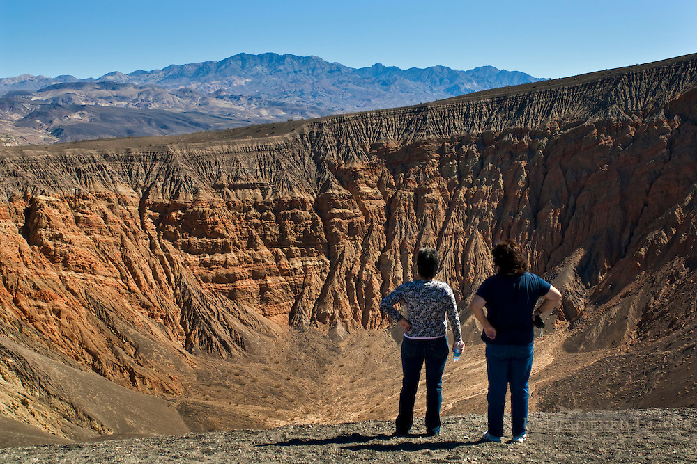 Tourists overlooking Ubehebe Crater, Death Valley National Park, California