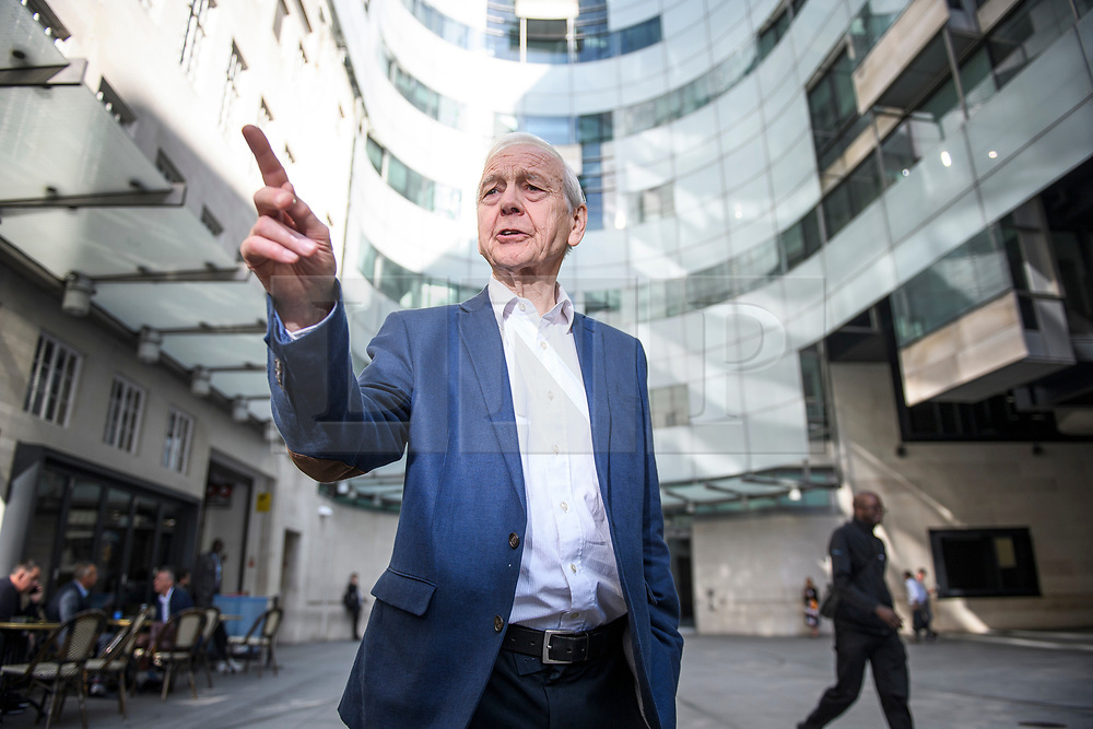 © Licensed to London News Pictures. 19/09/2019. London, UK. Veteran broadcaster JOHN HUMPHRYS is seen posing for a photograph as he leaves BBC Broadcasting House in London following his final day on the BBC Radio 4 Today Programme. Photo credit: Ben Cawthra/LNP
