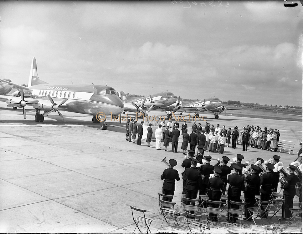 """27/05/1956<br /> 05/27/1956<br /> 27 May 1956<br /> Blessing of the Aer Lingus fleet at Dublin Airport. Prayers being said before Vickers Viscount """"Brendan"""" and DC3's """"Colmcille"""" and """"Malachy"""". Note band in right foreground."""