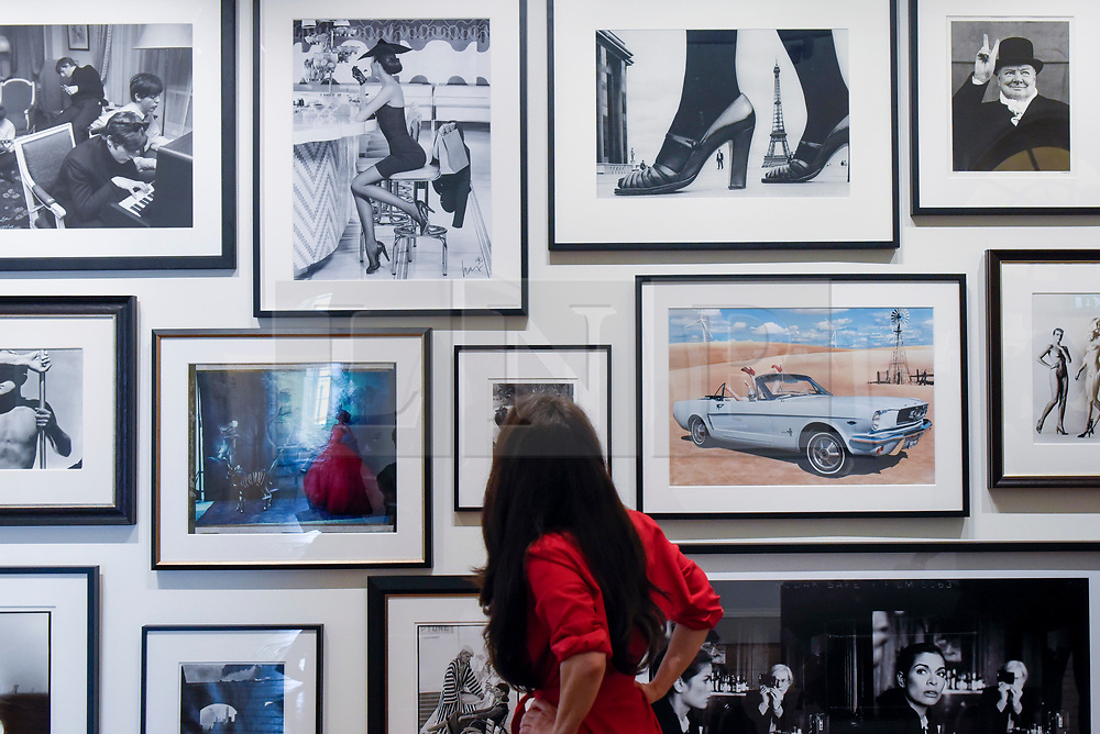 London, UK.  17 May 2017.  A woman views a collection of images of the rich and famous. Preview of Photo London 2017 at Somerset House.  Held for the third time, the event showcases the best in contemporary photography, from 89 galleries from 16 different countries, for collectors and enthusiasts and will be on from 18 - 21 May. Credit: Stephen Chung / Alamy Live News