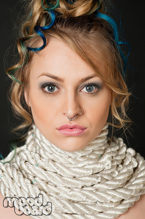Portrait of beautiful blond female with rope around neck