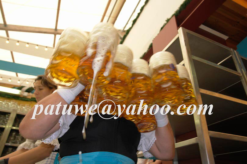 Liter of beer serve by server, Oktoberfest in Theresienwiese, Munich, Bavaria, Germany