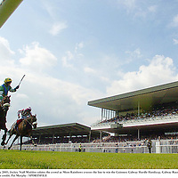 28 July 2005; Jockey Niall Madden salutes the crowd as More Rainbows crosses the line to win the Guinness Galway Hurdle Handicap. Galway Races, Ballybrit, Co. Galway. Picture credit; Pat Murphy / SPORTSFILE