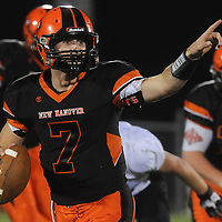New Hanover's Ward Coleman looks to throw against West Brunswick in football Friday October 24, 2014. (Jason A. Frizzelle)