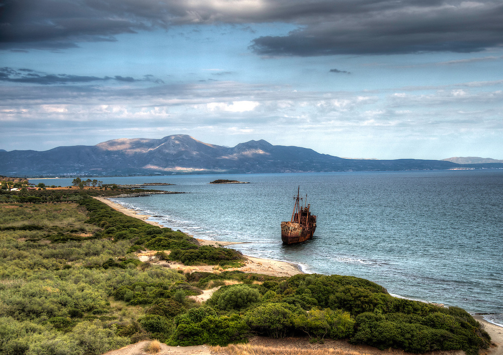 Beach with rusting ship-wreck