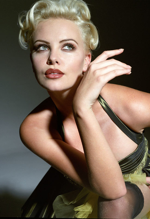 High-fashion stylized photo shoot with Charlize Theron by Nino Via