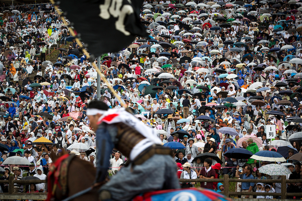 """MINAMISOMA, JAPAN - JULY 24 :  A samurai horseman is seen after completing the horse race """"Kacchu-keiba"""" (armed horse race) during the Soma Nomaoi festival at Hibarigahara field on Sunday, July 24, 2016 in Minamisoma, Fukushima Prefecture, Japan. """"Soma-Nomaoi"""" is a three day traditional festival that recreates a samurai battle scene from more than 1,000 years ago. The festival has gathered more than thousands visitors as Fukushima still continues to recovery from the 2011 nuclear disaster, the samurai warriors battles for recovery of the area. (Photo: Richard Atrero de Guzman/NURPhoto)"""