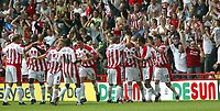 Fotball<br /> Nationwide First League England<br /> 23.08.2003<br /> Foto: Digitalsport<br /> Norway Only<br /> <br /> Photo. Andrew Unwin<br /> Sheffield United v Norwich, Nationwide League Division One, Bramall Lane, Sheffield 24/08/2003.<br /> Sheffield United's Robert Page (third from right) is mobbed by his team after scoring the first goal of the game.