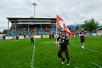 KELOWNA, BC - SEPTEMBER 8:  Jonah Williams #34 of Okanagan Sun carries the flag onto the field against the Langley Rams  at the Apple Bowl on September 8, 2019 in Kelowna, Canada. (Photo by Marissa Baecker/Shoot the Breeze)