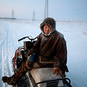 Reindeer herder Simyon travel hours by sled from his tent in the tundra to buy supplies at the village shop in Sovetsky..Construction of gas pipelines in the tundra is threatening the herders? way of life, forcing them to travel further afield in search of pastures.Vorkuta is a coal mining and former Gulag town 1,200 miles north east of Moscow, beyond the Arctic Circle, where temperatures in winter drop to -50C. .Here, whole villages are being slowly deserted and reclaimed by snow, while the financial crisis is squeezing coal mining companies that already struggle to find workers..Moscow says its Far North is a strategic region, targeting huge investment to exploit its oil and gas resources. But there is a paradox: the Far North is actually dying. Every year thousands of people from towns and cities in the Russian Arctic are fleeing south. The system of subsidies that propped up Siberia and the Arctic in the Soviet times has crumbled. Now there?s no advantage to living in the Far North - salaries are no higher than in central Russia and prices for goods are higher.