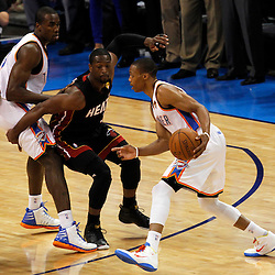 Jun 14, 2012; Oklahoma City, OK, USA;  Oklahoma City Thunder point guard Russell Westbrook (0) drives against Miami Heat shooting guard Dwyane Wade (3) during the first quarter of game two in the 2012 NBA Finals at Chesapeake Energy Arena. Mandatory Credit: Derick E. Hingle-US PRESSWIRE