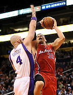 Dec. 23, 2012; Phoenix, AZ, USA; Los Angeles Clippers forward Blake Griffin (32) puts the ball during the game against the Phoenix Suns center Marcin Gortat (4) in the first half at US Airways Center. Mandatory Credit: Jennifer Stewart-USA TODAY Sports