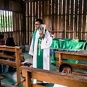 Holy mass in the small church in Cucuì, Amazonia. Triple border Brazil, Colombia and Venezuela