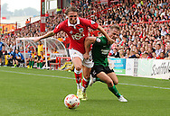 Luke Ayling (left) of Bristol City and Gary McSheffrey (right) of Scunthorpe United battle for the ball during the Sky Bet League 1 match at Ashton Gate, Bristol<br /> Picture by Tom Smith/Focus Images Ltd 07545141164<br /> 06/09/2014