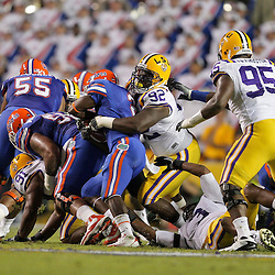 Oct 10, 2009; Baton Rouge, LA, USA; LSU Tigers defensive tackle Drake Nevis (92) tackles Florida Gators running back Jeffery Demps (2) during the first half at Tiger Stadium. Florida defeated LSU 13-3. Mandatory Credit: Derick E. Hingle-US PRESSWIRE