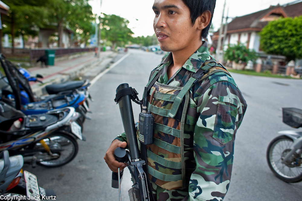 """26 SEPTEMBER 2009 -- PATTANI, THAILAND: A Thai soldier uses a GT200 explosives detector during an army security operation near Krue Se Mosque in Pattani, Thailand, Sept 26. Thailand's three southern most provinces; Yala, Pattani and Narathiwat are often called """"restive"""" and a decades long Muslim insurgency has gained traction recently. Nearly 4,000 people have been killed since 2004. The three southern provinces are under emergency control and there are more than 60,000 Thai military, police and paramilitary militia forces trying to keep the peace battling insurgents who favor car bombs and assassination.   PHOTO BY JACK KURTZ"""