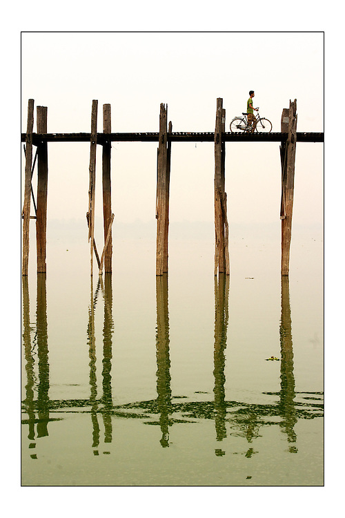 SMALL version - 9&quot;X6&quot; (23X15 cm) <br /> Man pushes his bycicle over U-Bein bridge near Mandalay. This teak footbridge of 1.3Km across Taungthaman lake is the longest in the world. A set of special edition prints on offer at a special price to raise money for the earthquakes that devastated Central Italy and Central Myanmar at the end of August 2016. Each print comes with a wide border on fine-art paper ready to be framed on standard size mounts. <br />  I will donate all profits to charities helping the victims of the earthquakes.