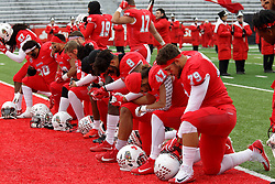 NORMAL, IL - November 17: A line of Redbirds kneel in the south endzone for a prayer moment prior to the start of a college football game between the ISU (Illinois State University) Redbirds and the Youngstown State Penguins on November 17 2018 at Hancock Stadium in Normal, IL. (Photo by Alan Look)