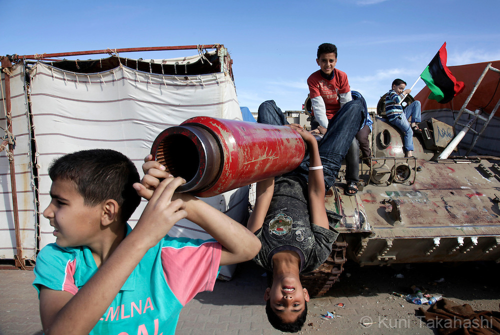 Boys play on an abandoned tank in Benghazi, Libya on May 20, 2011. NATO airstrikes against Moammar Gadhafi's forces resumed in Tripoli overnight. A Libyan government official said six sea vessels docked in the city's port were hit..Photo by Kuni Takahashi