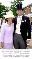 The HON.HARRY & MRS HERBERT he is the son of the Earl of Carnarvon, at Royal Ascot on 19th June 2001. 	OPN 148