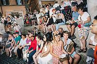 """ROME, ITALY - 20 JUNE 2017: Tourists are seen here relaxing by the Trevi Fountain in Rome, Italy, on June 20th 2017.<br /> <br /> The warm weather has brought a menacing whiff of tourists behaving badly in Rome. On April 12, a man went skinny-dipping in the Trevi fountain resulting in a viral web video and a 500 euro fine.<br /> <br /> Virginia Raggi, the mayor of Rome and a national figurehead of the anti-establishment Five Star Movement,  issued an ordinance involving harsher fines for eating, drinking or sitting on the fountains, for washing animals or clothes in the fountain water or for throwing anything other than coins into the water of the Trevi Fountain, Bernini's Four Fountains and 35 other city fountains of artistic or historic significance around the city.  """"It is unacceptable that someone use them to go swimming or clean themselves, it's an historic patrimony that we must safeguard,"""" Ms. Raggi said."""