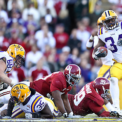 November 6, 2010; Baton Rouge, LA, USA;  LSU Tigers running back Stevan Ridley (34) breaks away from Alabama Crimson Tide defensive tackle Josh Chapman (99) and linebacker Dont'a Hightower (30) during the second half at Tiger Stadium. LSU defeated Alabama 24-21.  Mandatory Credit: Derick E. Hingle