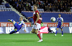 Wigan Athletic's Joe Garner (left) and Bristol City's Tomas Kalas (right) battle for the ball during the Sky Bet Championship match at the DW Stadium, Wigan.
