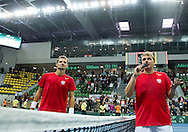 (L) Mariusz Fyrstenberg & (R) Marcin Matkowski both from Poland celebrate their victory at men's double game during second day of the BNP Paribas Davis Cup 2013 between Poland and South Africa at MOSiR Hall in Zielona Gora on April 06, 2013...Poland, Zielona Gora, April 06, 2013..Picture also available in RAW (NEF) or TIFF format on special request...For editorial use only. Any commercial or promotional use requires permission...Photo by © Adam Nurkiewicz / Mediasport