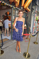 OLIVIA COLE at the 10th anniversary party of the store Caramel, Ledbury Road, London W11.  The party was held in association with the Naked Heart Foundation - a charity set up by model Natalia Vodianova.