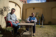 CAIRO, EGYPT - FEBRUARY 25: Al Jazeera English (AJE) producer Baher Mohamed (l) talks with his father Hazem February 25, 2015 in the garden at their family villa in the Sheikh Zayed district on the outskirts of Cairo, Egypt. Baher, and fellow Al Jazeera defendent Mohamed Fahmy were conditionally released on Feb 12, 2015 following Egypt's highest appeal courts decision to grant them a retrial, which has since been postponed until March 8. (Photo by Scott Nelson, for the Washington Post)