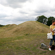 "The Royal Mounds, Kungshögarna, hold the remains of three Kings of Sweden of the legendary House of Ynglings.  Gamla Uppsala, ""Old Uppsala"", dating back to the 3rd century A.D. was known throughout Northern Europe as the residence of the Swedish kings of the legendary House of Yngling Dynasty. <br /> Photography by Jose More"