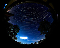 Star trails over New Jersey. Composite of images (21:26 to 22:29) taken with a Nikon D850 camera and 8-15 mm fisheye lens (ISO 100, 8 mm, f/4, 30 sec). Raw images processed with Capture One Pro, and the composite generated using Photoshop CC (statistics, maximum).
