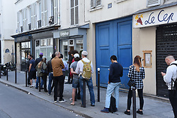 """People queue outside CBD coffee shop """"Cofyshop"""" in Paris on June 21, 2018. The first cannabis coffee shops are opening in the Paris region as the legal use of CBD (cannabidiol) spreads across the country. Two establishments have begun selling the product in recent weeks. They sell legal cannabis, known as CBD, in several formats. The Minister for Health announced in November 2017 that the presence of CBD in products for public consumption was authorized. Photo by Alain Apaydin/ABACAPRESS.COM"""