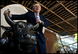 London Mayor Boris Johnson with the Bull outside the Bombay Stock Exchange, Mumbai, after opening the day's trading, on the final day of his 6 day tour of India, Friday November 30, 2012. Photo by Andrew Parsons / i-Images