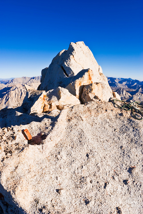 SPOT messenger on the summit of Bear Creek Spire, John Muir Wilderness, Sierra Nevada Mountains, California