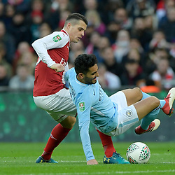 Ilkay Gundogan of Manchester City is fouled by Granit Xhaka of Arsenal