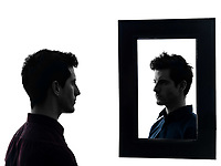 man in front of his mirror in shadow white background