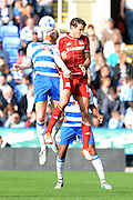 Reading defender Paul McShane and Middlesbrough striker Christian Stuani challenge for the ball during the Sky Bet Championship match between Reading and Middlesbrough at the Madejski Stadium, Reading, England on 3 October 2015. Photo by Alan Franklin.